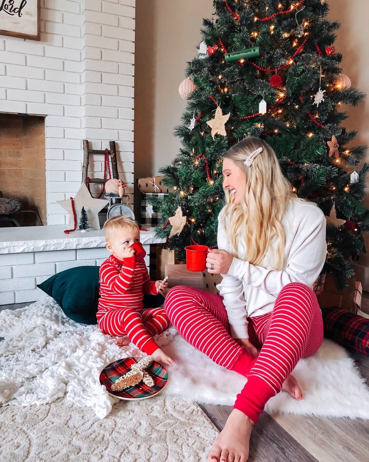 Mom and son photo ideas - milk and cookies indoor picnic by the Christmas tree picture idea