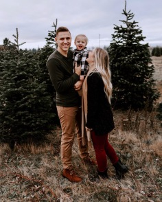 family photo session at a Christmas tree farm